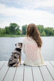 Austrailian Shepherd & girl sitting on the dock - Adorable Dog Pics