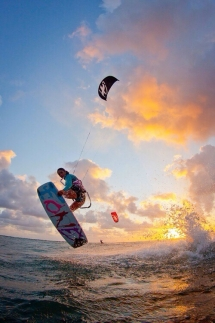 Kiteboarding into the sunset - Kitesurfing