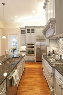 Nice grey kitchen cabinets; very clean looking - Great designs for the home