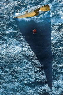 Racing yacht casting a shadow [photo] - Beautiful ocean