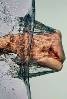 Take that water!  Fist through water [photo] - Fantastic shots