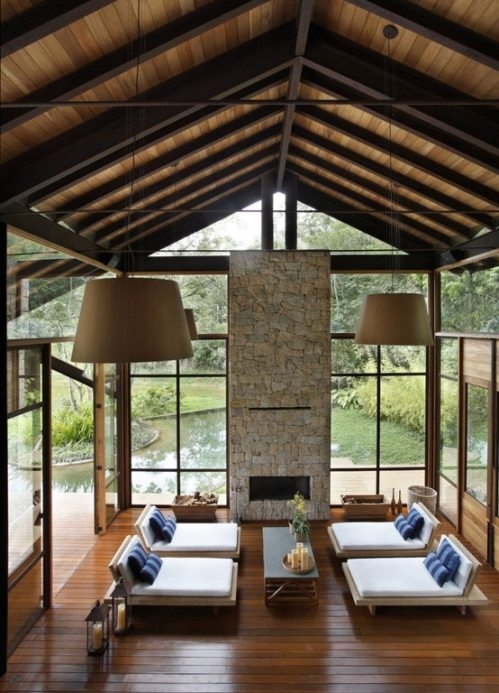 A room of glass, wood, and stone brings nature in
