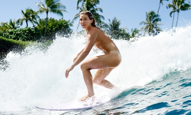 Coco Ho bares it all hits the surf - Image 2