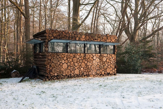 A small building that looks like a stack of logs FaveThingcom