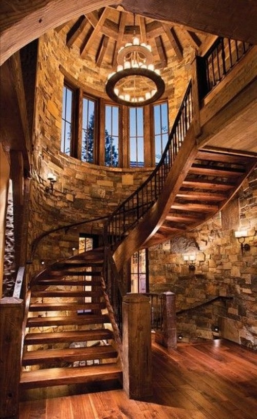 Massive wooden spiral staircase in large stone stairway for Dream wooden house