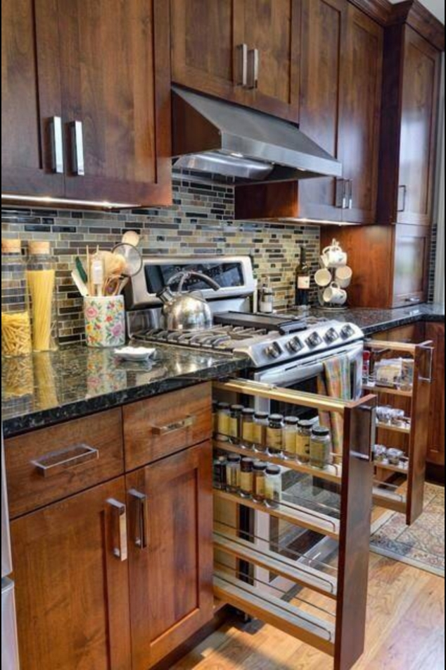 Slide-out spice rack on either side of stove
