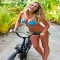 Anne V taking a bike out in a Tyler Rose Swimwear bikini - Swimsuits of Sports Illustrated