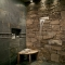 Shower with stone and waterfall spout - Dream Bathrooms